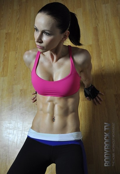 A young woman with well defined abs muscles